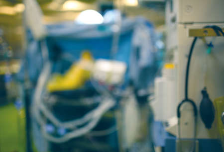 Defocused background of blurry operating room during surgery.