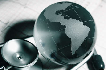 Glass globe and stethoscope as a global health protection concept.