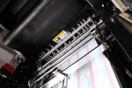 Printing press with blurry turning conveyor belt during work.