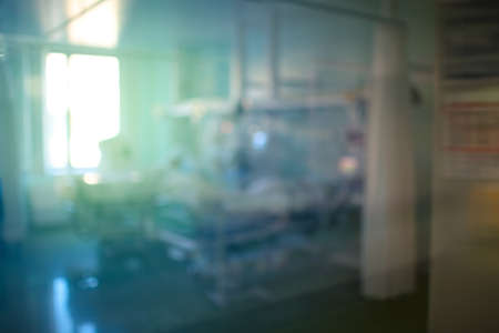Unfocused view on the intensive care unit through the window glass.