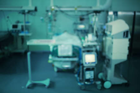 Blurry background of equipment around the patient in the ICU.