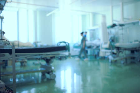 Working medical staff in the intensive care unit, unfocused background.