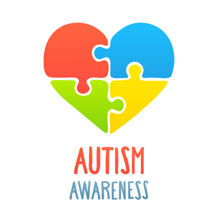 Autism awareness heart with jigsaw puzzle symbol.