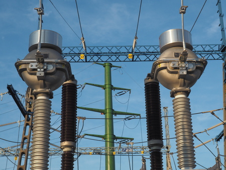 High voltage power substation at blue sky background