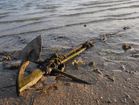 n old anchor dropped on the Koh Phangan's beach Stock Photo - 119886026
