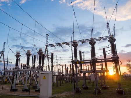 High voltage power substation in the sunset sky