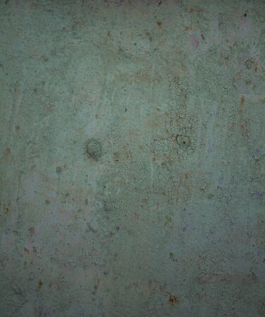 chipped paint: old sheet iron with surface coating with chipped paint green