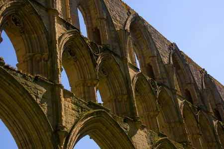11th century: Arches on a 11th century ruins in rural Britain. Stock Photo