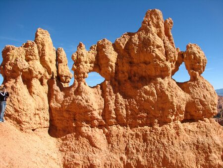 hoodoos: Holes in the multicoloured Hoodoos at Bryce Canyon