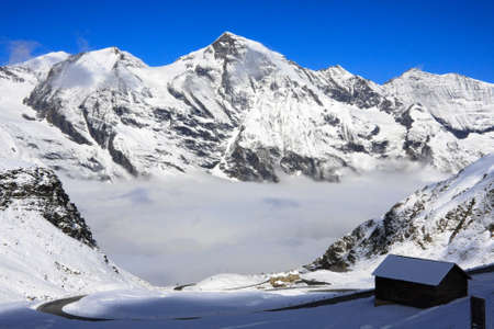 Above the clouds in the Austrain Mountains Stock Photo - 8219667