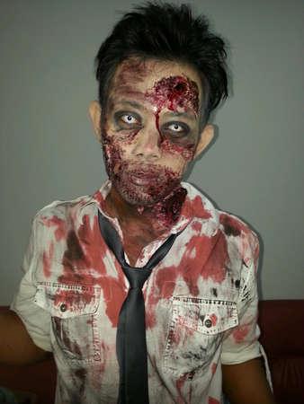 Portrait of scary zombie shot on head