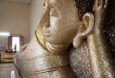 recline: the left reclining Buddha at Wat phaphadu,Rayong,Thailand