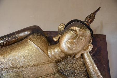 recline: The left reclining Buddha at Wat phaphadu,Rayong,Thailand Stock Photo