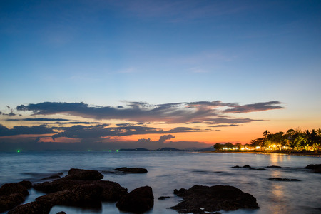 tangalla: Long Exposure image of sea and blue and orange sky after sunset at a beach Stock Photo