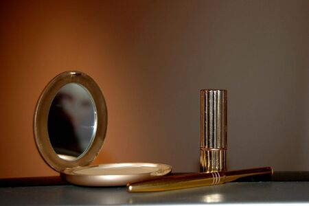 Cosmetics in gold cases