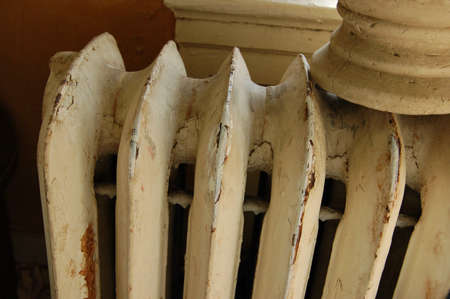 Old radiator in city apartment