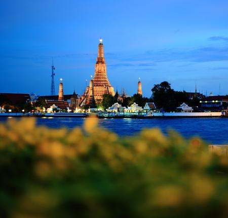 Temple of dawn or Arun temple, Bangkok, Thailand. A major Buddhist site for tourism travel destination near Chao Praya river shot during Twilight hour. Editorial