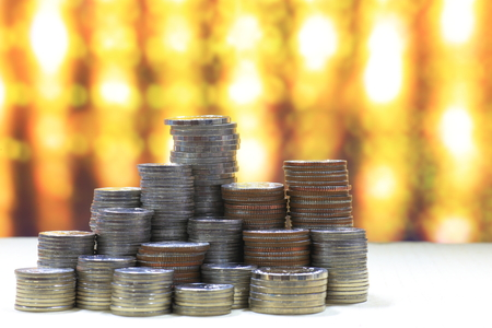 pile of coin stack on golden light background, financial success concept