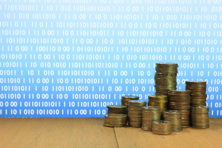 Digital economy. Coin stack increasing chart shape with Blue light and binary digital numbers background. Business, finance and saving concept. Stock Photo