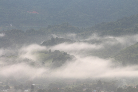 misty mountain. rocky mountain covered by morning fog. moisture collect in the night and seep out in the morning.