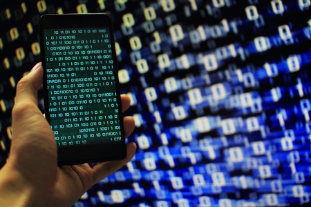 Missing data. multiple layer of information on mobile screen some missing from screen and error occurred. binary code on mobile and computer screen in the background. blue code computer matrix.