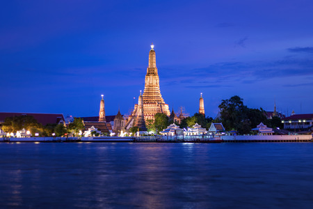 Arun temple. Bangkok major landmark. Pagoda of Thai buddhist temple of the dawn. Night landscape of cultural landmark across Chaopraya river.