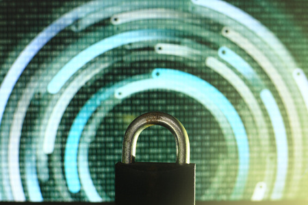 closed padlock in front of green matrix and circular lines background. cyber and computer security concept. privacy protection against hackers, virus and spyware.