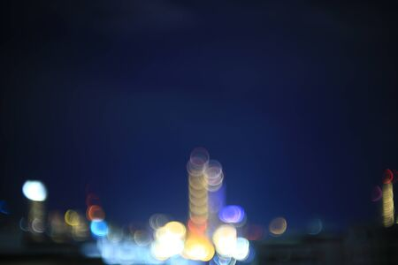 blur city sky night light. bokeh defocus light from building in a metropolis. business and city life concepts background.