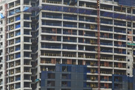 building under construction. reinforced concrete structure completed. work on cladding and exterior finishing. development, progress and growth concepts Imagens