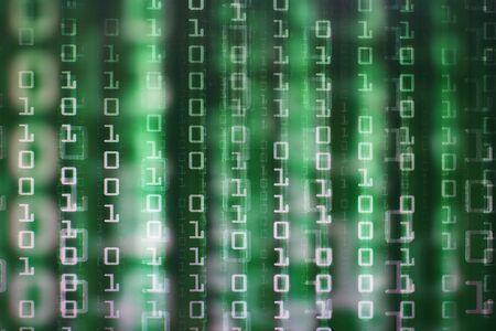 binary code matrix. digital led light from computer screen monitor displaying downward text movement. multiple layers of green matrix image Reklamní fotografie