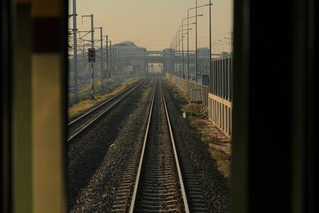 railway tracks. one point perspective view of a strait long train rail track. train path in a rural area.
