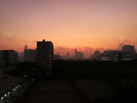 dust hanging in the air covering the city. Bangkok Thailand under thick fog of dust particles air pollution. morning sky view obscured by smog.