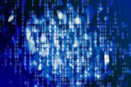 Blue binary code blocks flowing downward. Reklamní fotografie
