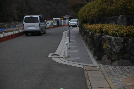footpath neatly constructed. pedestrian walkway on the same level elevation with road separate by lighting Bollards.