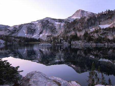 Mountains mirrored in lake photo