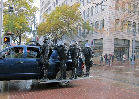 PORTLAND, OREGON - NOV 17  Police in Riot Gear Entering Downtown Portland, Oregon during a Occupy Portland protest on the first anniversary of Occupy Wall Street November 17, 2011 Editorial