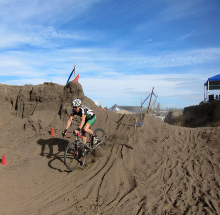 Cyclocross racer bicycles over sand obstacle