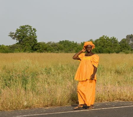 Pregnant woman in traditional dress in The Gambia Stock Photo - 4849140