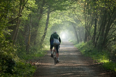 rambling: Older man cycling into distance