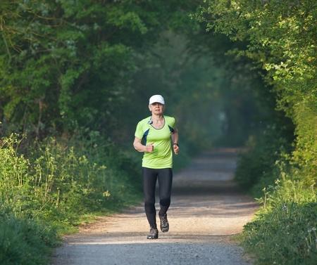 Older woman running photo