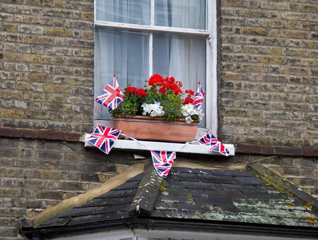 London house decorated with celebration red, white and blue flowers and Union Flag bunting to mark the Diamond Jubilee of  Her Majesty Queen Elizabeth II in June, 2012 photo