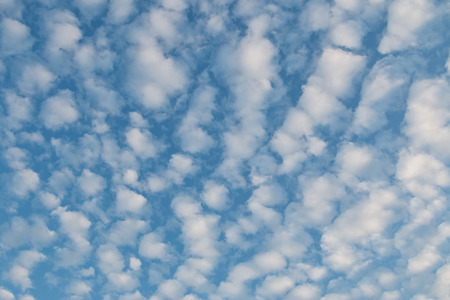 altocumulus: Altocumulus Clouds forming pattern against blue sky Stock Photo