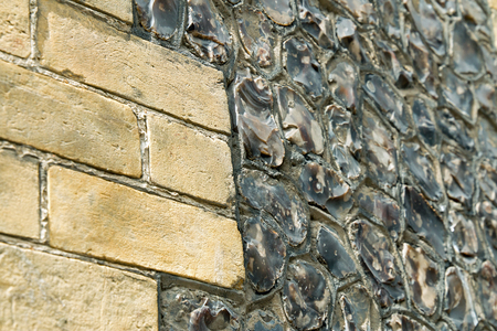 sussex: Sussex house wall made of sandstone brick and random snapped field flints.