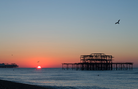 November sunrise between Brightons piers. Stock Photo