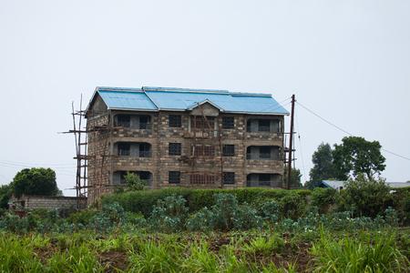 nairobi: Nairobi building construction showing local wooden scaffolding