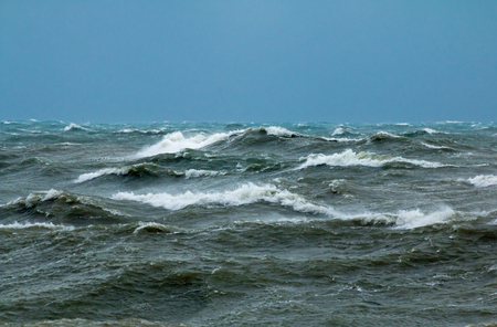 Rough seas with crashing waves in English Channel off Seaford in East Sussex.