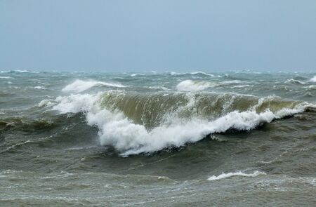 Rough sea with crashing waves in English Channel off Seaford in East Sussex