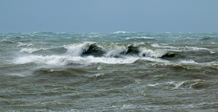 Rough sea in English Channel off Seaford in East Sussex with waves breaking and spindrift.