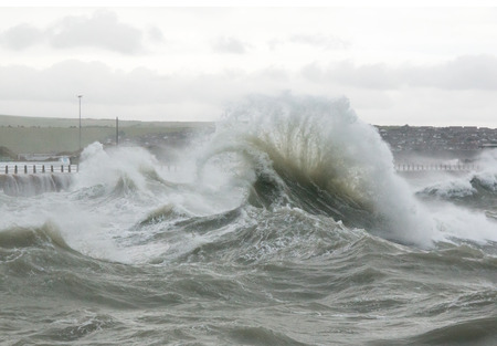 Curling wave and spray at Newhaven Harbour in Sussex