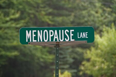 menopause: Green street sign with white letters for Menopause Lane Stock Photo